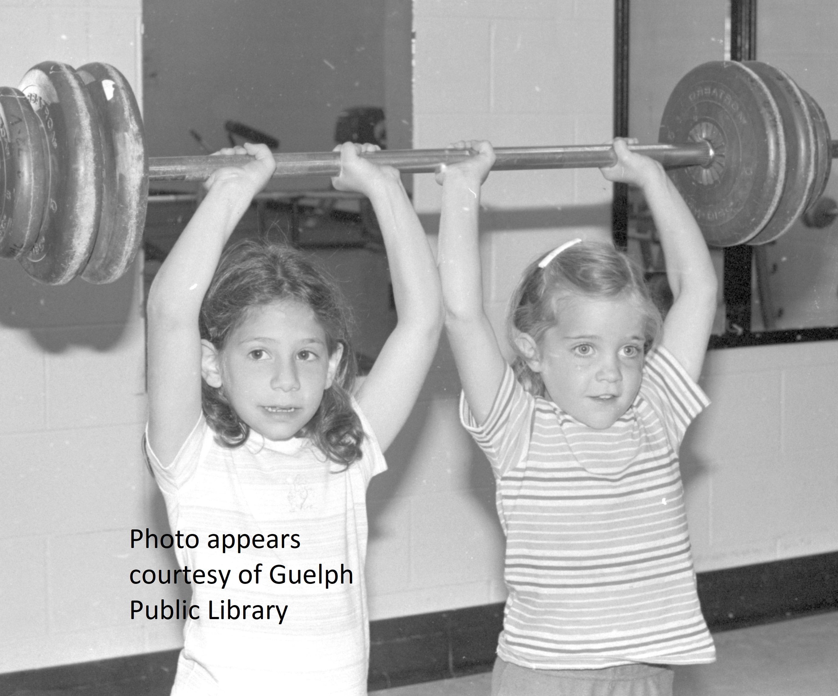 2 young girls weightlifting